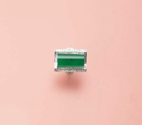 A JADEITE AND DIAMOND RING