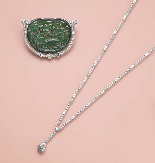 A CARVED JADEITE AND DIAMOND P