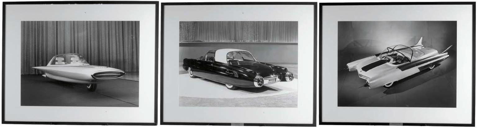 A set of three framed photogra