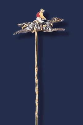 AN EDWARDIAN ENAMEL AND DIAMON