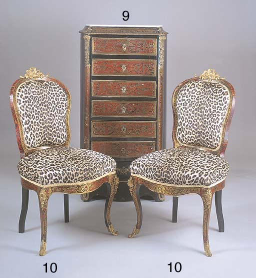 * A PAIR OF NAPOLEON III EBONISED RED TORTOISESHELL AND ORMOLU MOUNTED SALON CHAIRS