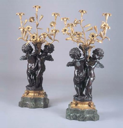 A PAIR OF GILT AND PATINATED B