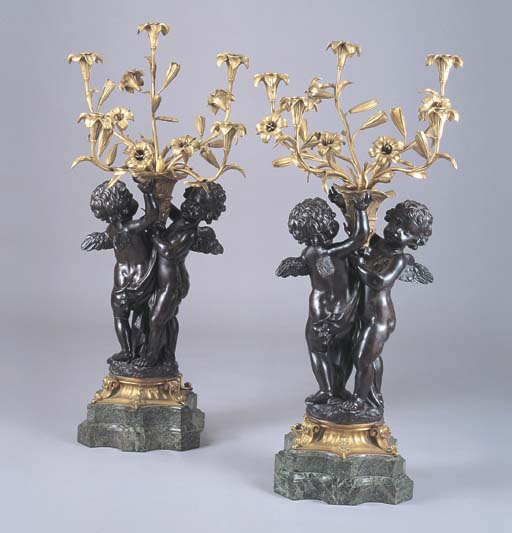 A PAIR OF GILT AND PATINATED BRONZE, GREEN MARBLE FIGURAL CANDELABRA