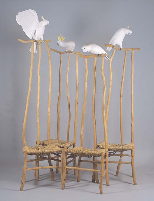 A SET OF FOUR COCKATOO CHAIRS