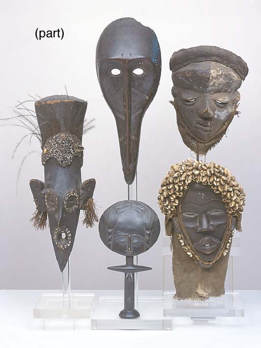 A COLLECTION OF AFRICAN AND ASIAN MASKS AND CARVD HEADS