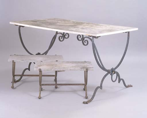 A WROUGHT IRON AND WHITE MARBLE GARDEN TABLE