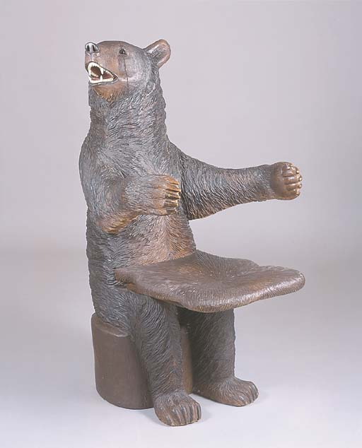 A SWISS 'BLACK FORREST' CARVED BEAR ARMCHAIR