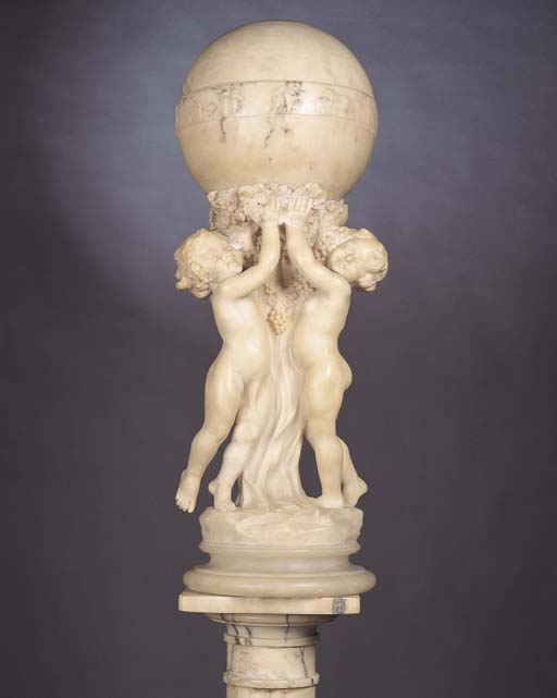 AN ART DECO CARVED ALABASTER F