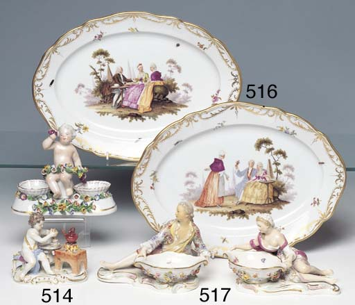 A MEISSEN FIGURE OF A PUTTO MAKING HOT CHOCOLATE AND A DOUBLE SALT