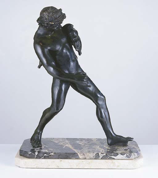 A BRONZE FIGURE OF A FAUN WITH