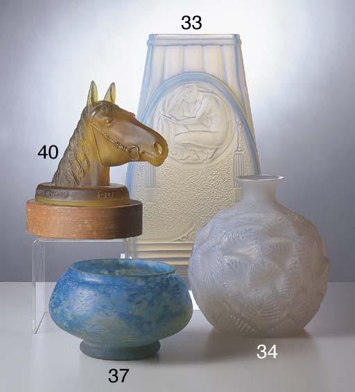 AN AMBER GLASS MASCOT OF PHAR