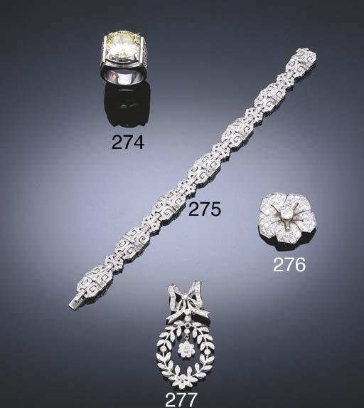 A DIAMOND FLOWER BROOCH, BY CA