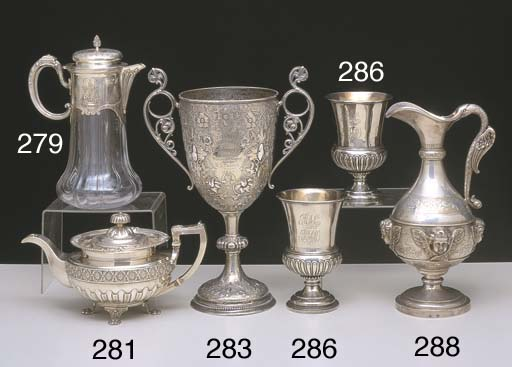 A FRENCH SILVER MOUNTED WINE J