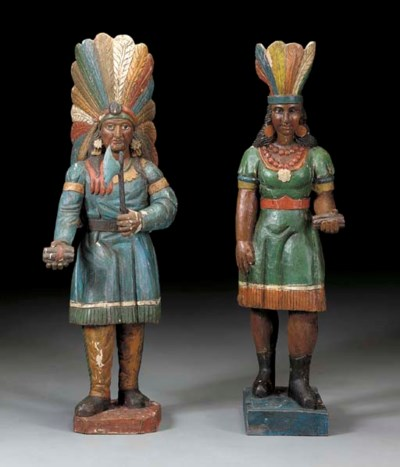 TWO PAINTED AND DECORATED CIGA