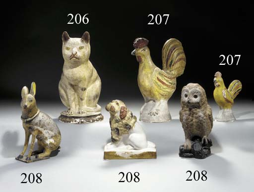 A MOLDED AND DECORATED CHALKWARE CAT