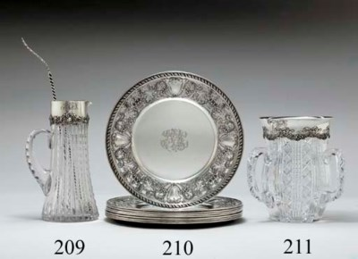 A SET OF EIGHT SILVER DINNER P