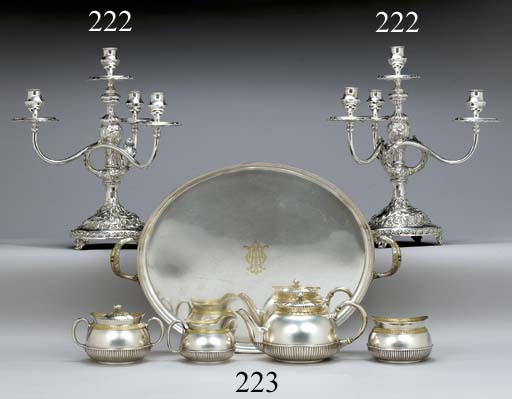 A PAIR OF SILVER FOUR-LIGHT CANDELABRA