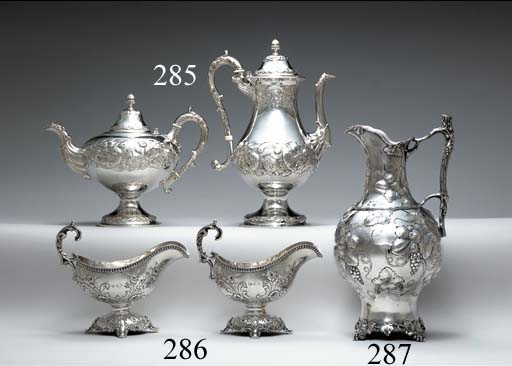A SILVER TEAPOT AND COFFEE POT**