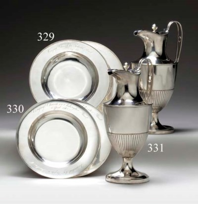 A PAIR OF SILVER ALMS DISHES