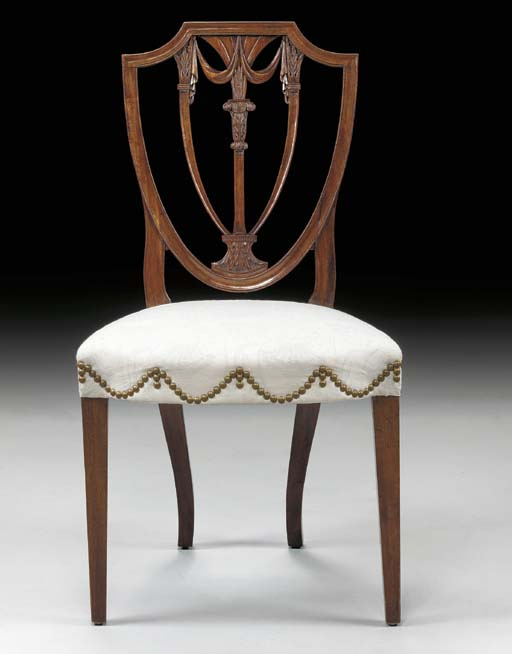 A FEDERAL CARVED MAHOGANY SHIELD BACK SIDE CHAIR