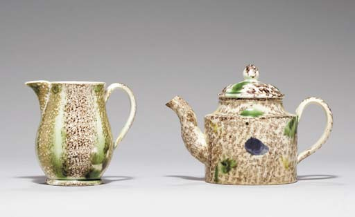 A STAFFORDSHIRE CREAMWARE TEAPOT AND COVER AND A PEARLWARE CREAM-JUG