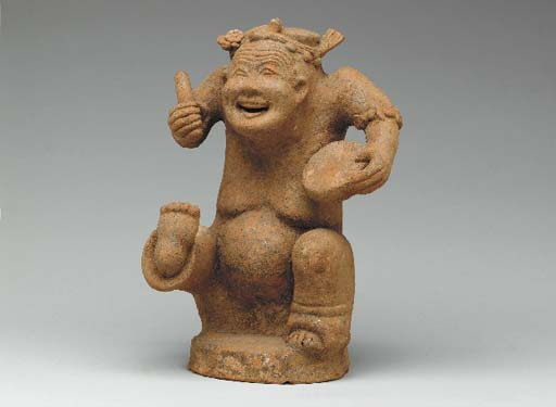 A Small Red Pottery Figure of