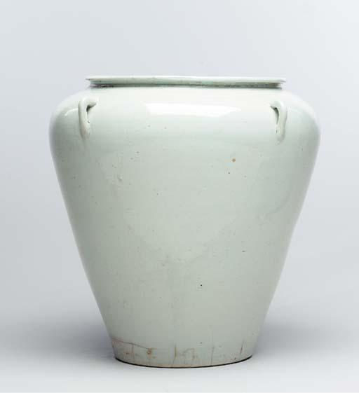 A Large White Porcelain Jar wi