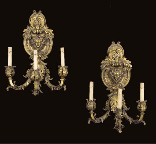 A pair of Regence style gilt-m