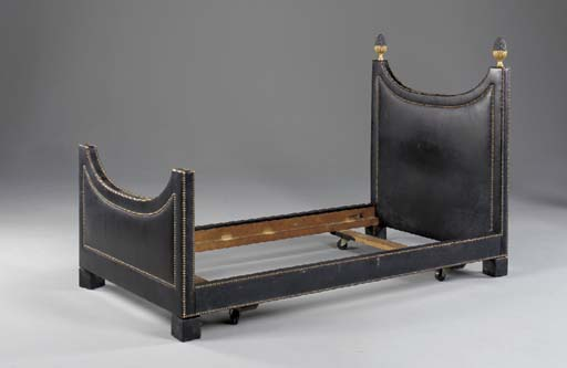 A LEATHER COVERED SINGLE BEDST
