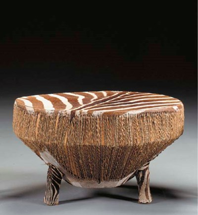 A ZEBRA SKIN-COVERED LOW TABLE