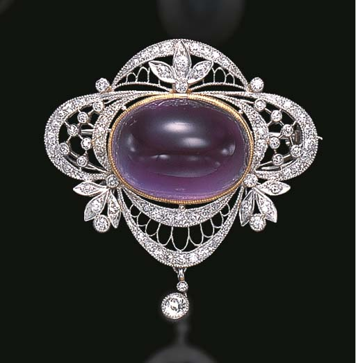 A BELLE EPOQUE AMETHYST AND DIAMOND BROOCH