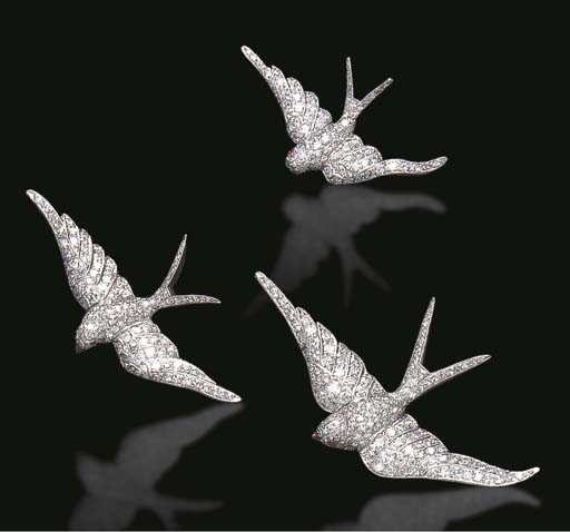 A GROUP OF DIAMOND AND RUBY BIRD BROOCHES