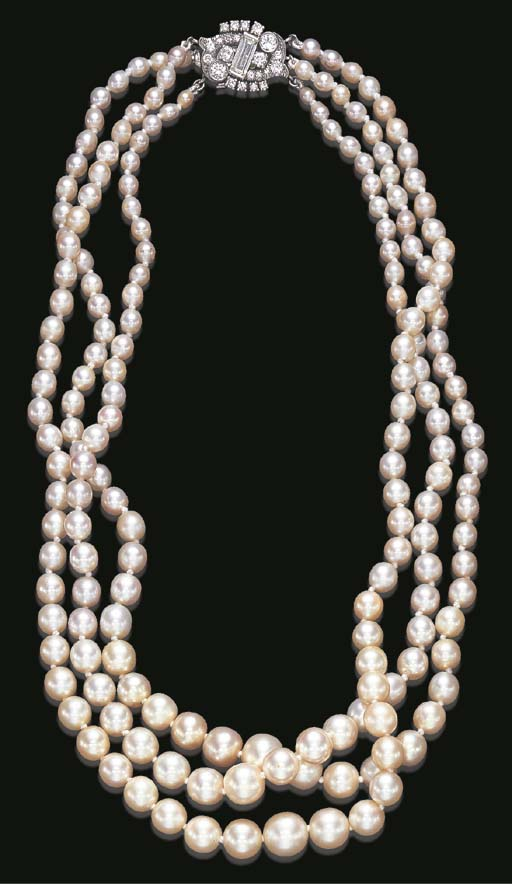 A TRIPLE-STRAND PEARL NECKLACE