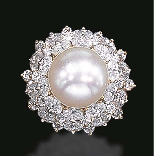 A DIAMOND AND CULTURED PEARL RING, BY OSCAR HEYMAN & BROTHERS