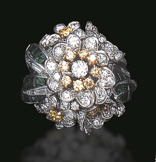 AN UNUSUAL EMERALD AND DIAMOND RING, BY SHREVE & CO.
