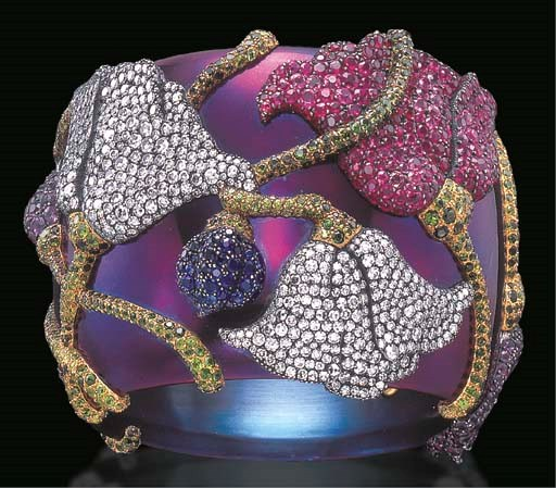 A magnificent 'Mogol' flower bangle bracelet, by JAR. Sold for $556,000 on 8-9 April 2002 at Christie's in New York