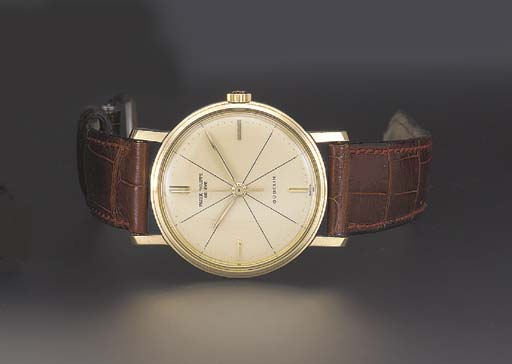 Patek Philippe. A 18K gold wristwatch with sweep center seconds