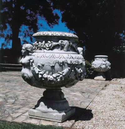 A pair of Italian carved white