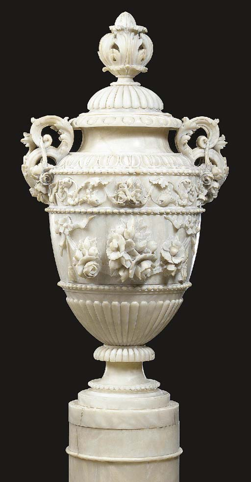An Italian carved alabaster tw