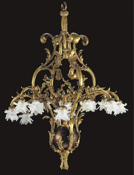 A Louis XV style ormolu and patinated-bronze twelve-light chandelier