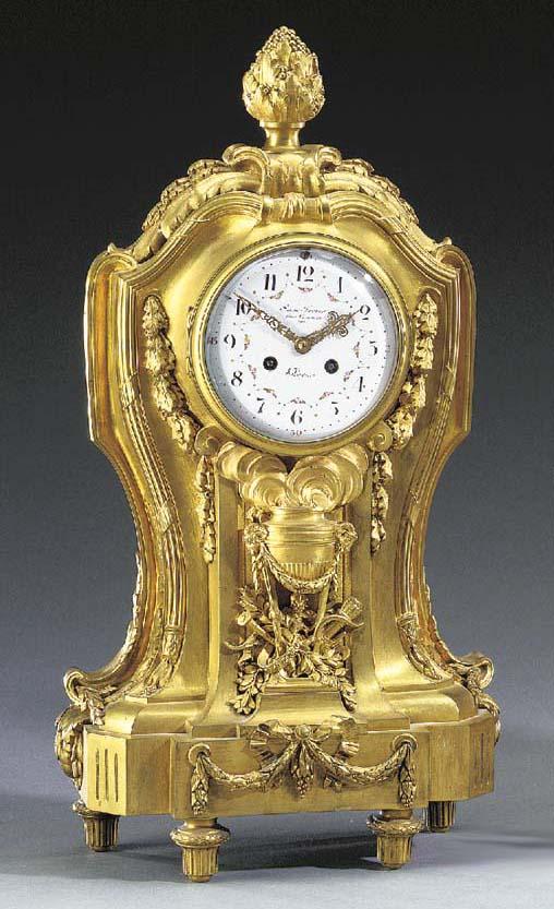 A Louis XVI style ormolu mantel clock