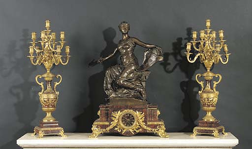 A French ormolu, patinated-bro