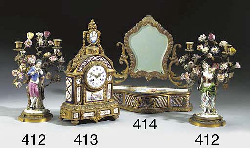 A French gilt-metal, champleve enamelled and porcelain-mounted dressing-table mirror