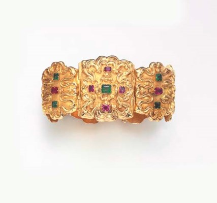 AN EMERALD, RUBY AND GOLD BRAC