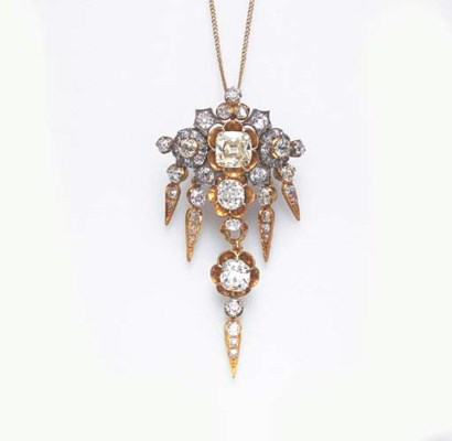 A DIAMOND PENDANT BROOCH