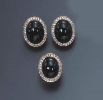 A SET OF ONYX AND DIAMOND JEWE
