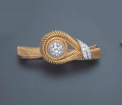 A RETRO DIAMOND AND GOLD WRIST