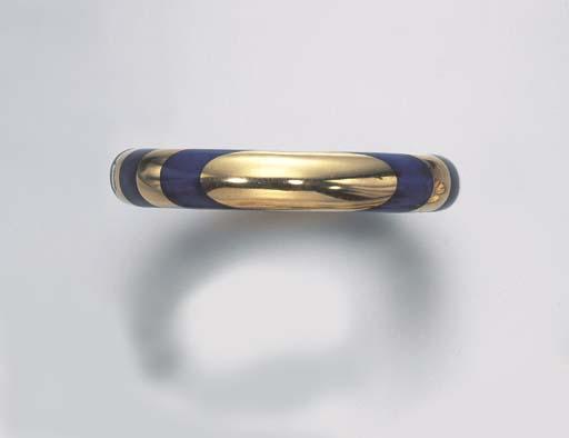 A LAPIS LAZULI AND GOLD BANGLE
