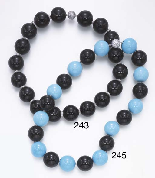 A ONYX AND DIAMOND NECKLACE
