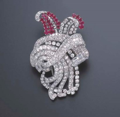 A DIAMOND AND RUBY BROOCH